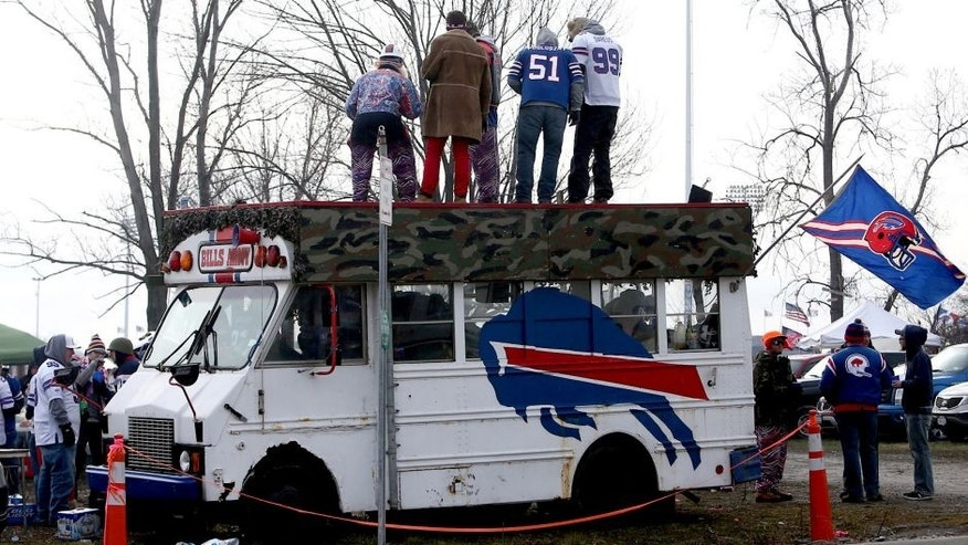 ORCHARD PARK, NY - DECEMBER 9: Fans of the Buffalo Bills take part in tailgating activities before an NFL game against the St. Louis Rams at Ralph Wilson Stadium on December 9, 2012 in Orchard Park, New York. (Photo by Tom Szczerbowski/Getty Images)