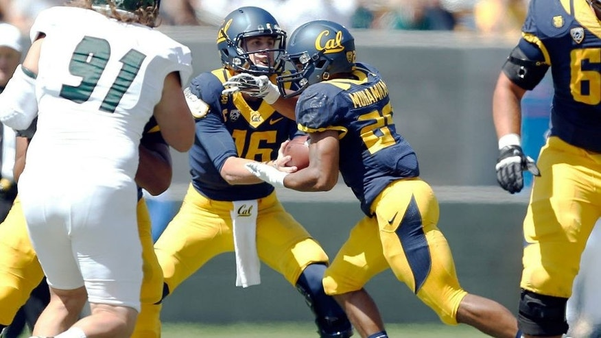 Sep 6, 2014; Berkeley, CA, USA; California Golden Bears quarterback Jared Goff (16) hands off to Golden Bears running back Khalfani Muhammad (29) during the first quarter against the Sacramento State Hornets at Memorial Stadium. Mandatory Credit: Bob Stanton-USA TODAY Sports