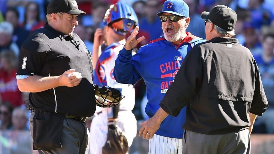 Sep 19, 2015; Chicago, IL, USA; Chicago Cubs manager Joe Maddon (70) argues with umpire Bruce Dreckman (1) and umpire Tom Hallion (20) at Wrigley Field. Mandatory Credit: Jasen Vinlove-USA TODAY Sports