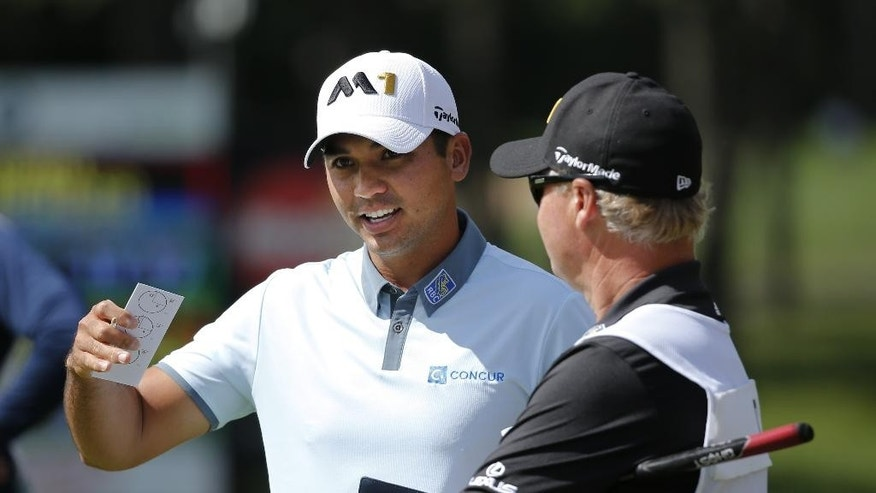 Jason Day, of Australia, left, talks with his caddie Colin Swatten on the second hole during the third round of the BMW Championship golf tournament at Conway Farms Golf Club, Saturday, Sept. 19, 2015, in Lake Forest, Ill. (AP Photo/Charles Rex Arbogast)