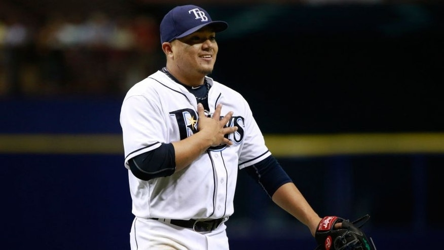 Sep 19, 2015; St. Petersburg, FL, USA; Tampa Bay Rays starting pitcher Erasmo Ramirez (30) reacts as they get the last out of the fifth inning against the Baltimore Orioles at Tropicana Field. Mandatory Credit: Kim Klement-USA TODAY Sports