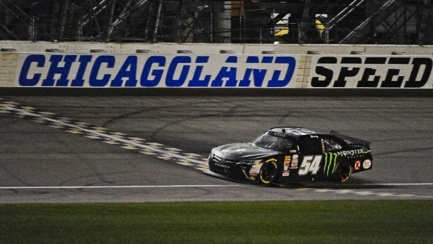 Kyle Busch wins the NASCAR Xfinity Series auto race at Chicagoland Speedway, Saturday, Sept. 19, 2015, in Joliet, Ill. (AP Photo/Matt Marton)