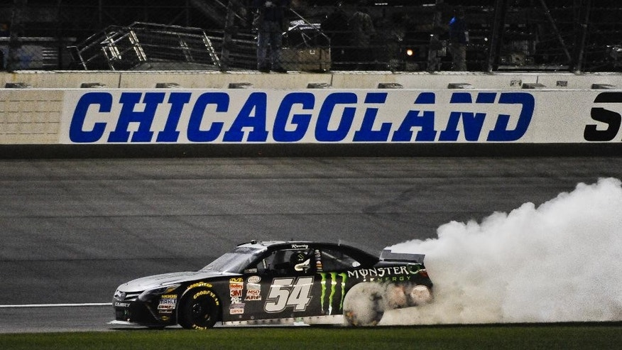 Kyle Busch does a burn out after he wins the NASCAR Xfinity Series auto race at Chicagoland Speedway, Saturday, Sept. 19, 2015, in Joliet, Ill. (AP Photo/Matt Marton)
