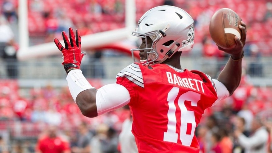 Sep 12, 2015; Columbus, OH, USA; Ohio State Buckeyes quarterback J.T. Barrett (16) warms up before the game against the Hawaii Warriors at Ohio Stadium. Mandatory Credit: Greg Bartram-USA TODAY Sports