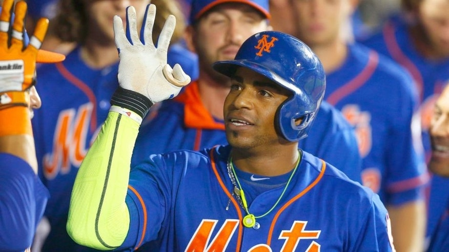 Yoenis Cespedes #52 of the New York Mets celebrates his eighth inning home run against the Philadelphia Phillies at Citi Field on September 2, 2015 in the Flushing neighborhood of the Queens borough of New York City. (Photo by Jim McIsaac/Getty Images)
