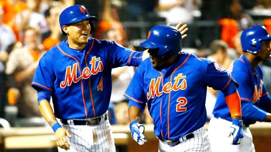 NEW YORK, NY - SEPTEMBER 18: Juan Uribe #2 of the New York Mets celebrates his two run home run with Wilmer Flores #4 and Curtis Granderson #3 against the New York Yankees during their game at Citi Field on September 18, 2015 in New York City. (Photo by Al Bello/Getty Images)
