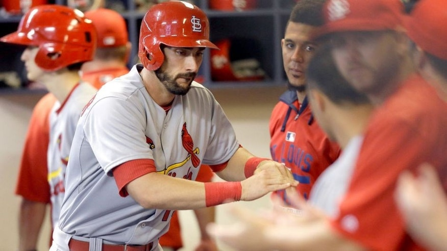 MILWAUKEE, WI - SEPTEMBER 17: Matt Carpenter #13 of the St. Louis Cardinals celebrates in the dugout after hitting a solo home run in the sixth inning against the Milwaukee Brewers at Miller Park on September 17, 2015 in Milwaukee, Wisconsin. (Photo by Mike McGinnis/Getty Images)