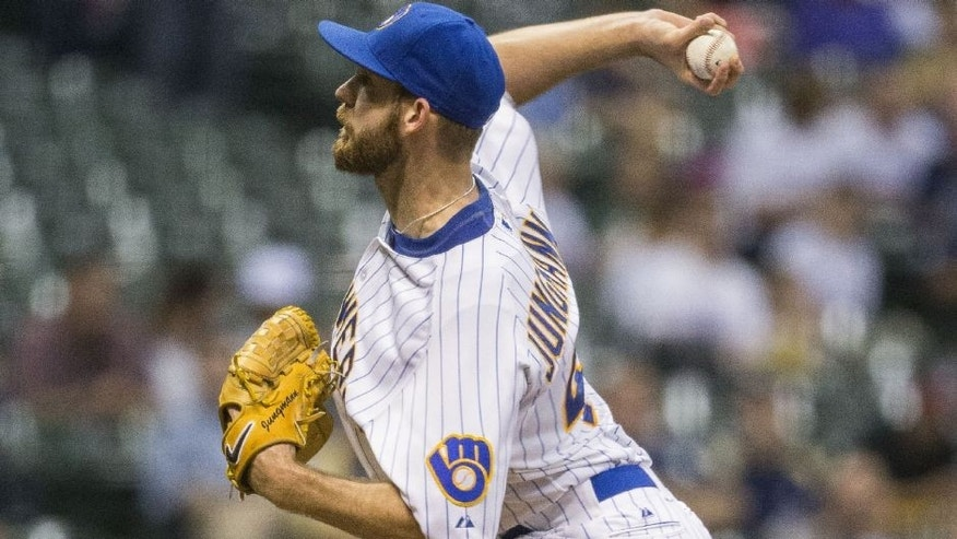<p>Milwaukee Brewers' Taylor Jungmann pitches to a Cincinnati Reds batter during the first inning of a baseball game Friday, Aug. 28, 2015, in Milwaukee. (AP Photo/Tom Lynn)</p>