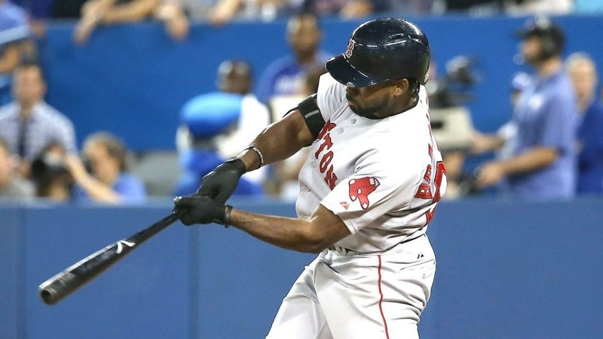 TORONTO, CANADA - SEPTEMBER 19: Jackie Bradley #25 of the Boston Red Sox hits a two-run home run in the ninth inning during MLB game action against the Toronto Blue Jays on September 19, 2015 at Rogers Centre in Toronto, Ontario, Canada. (Photo by Tom Szczerbowski/Getty Images)