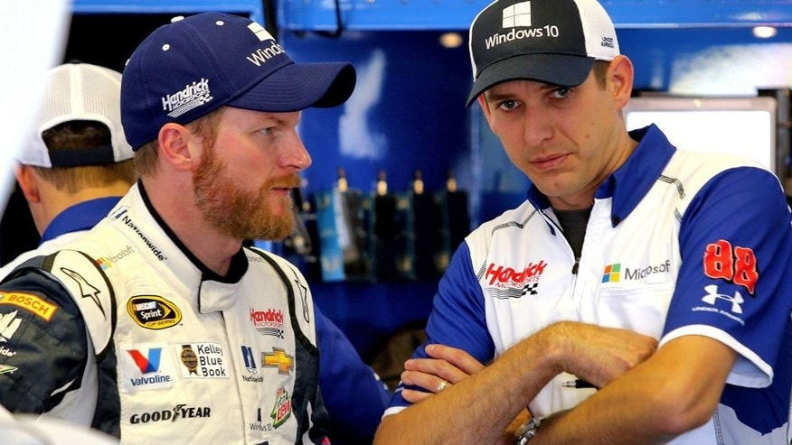 LONG POND, PA - JULY 31: Dale Earnhardt Jr., driver of the #88 Microsoft Chevrolet, left, talks with crew chief Greg Ives in the garage area during practice for the NASCAR Sprint Cup Series Windows 10 400 at Pocono Raceway on July 31, 2015 in Long Pond, Pennsylvania. (Photo by Jerry Markland/Getty Images)