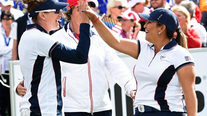 Brittany Lang, left, and Lizette Salas, right, both of United States, celebrate during the fourballs on Day2 at the Solheim Cup golf tournament in St. Leon-Rot, southern Germany, Saturday, Sept. 19, 2015. (AP Photo/Jens Meyer)