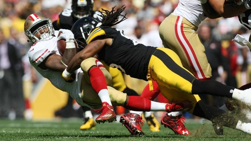 Sep 20, 2015; Pittsburgh, PA, USA; Pittsburgh Steelers liebacker Jarvis Jones (95) tackles San Francisco 49ers running back Carlos Hyde (28) during the first half at Heinz Field. Mandatory Credit: Jason Bridge-USA TODAY Sports