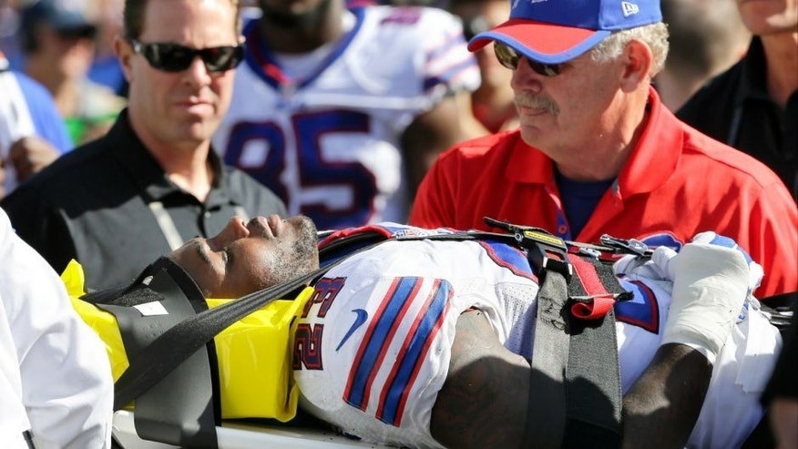 Buffalo Bills free safety Aaron Williams (23) is carted off the field during the second half of an NFL football game against the New England Patriots Sunday, Sept. 20, 2015, in Orchard Park, N.Y. (AP Photo/Bill Wippert)