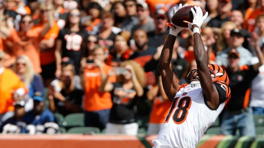 Sep 20, 2015; Cincinnati, OH, USA; Cincinnati Bengals wide receiver A.J. Green (18) catches a pass for a touchdown over San Diego Chargers cornerback Brandon Flowers (24) in the first half at Paul Brown Stadium. Mandatory Credit: Aaron Doster-USA TODAY Sports