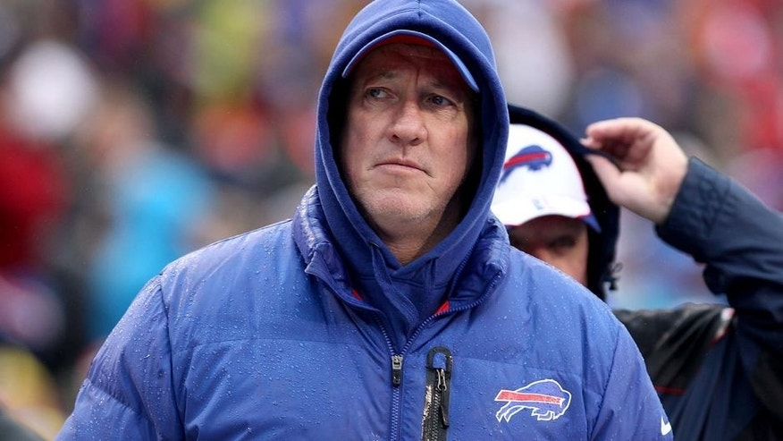 Dec 22, 2013; Orchard Park, NY, USA; Buffalo Bills former quarterback Jim Kelly on the sidelines during a game against the Miami Dolphins at Ralph Wilson Stadium. Mandatory Credit: Timothy T. Ludwig-USA TODAY Sports