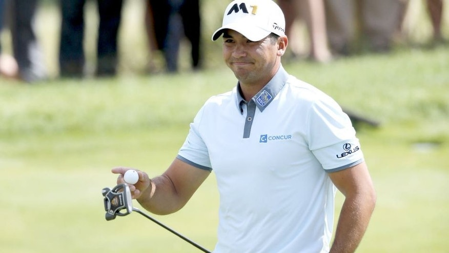 Jason Day, of Australia, acknowledges the crowd's applause after making birdie on the third hole during the third round of the BMW Championship golf tournament at Conway Farms Golf Club, Saturday, Sept. 19, 2015, in Lake Forest, Ill. (AP Photo/Charles Rex Arbogast)
