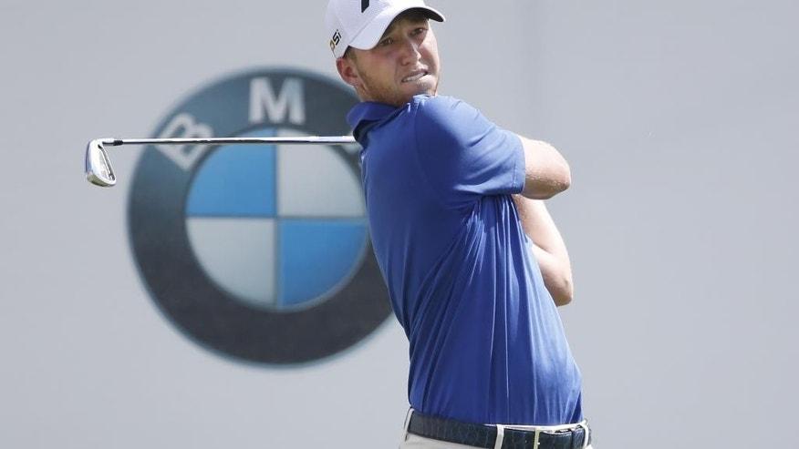 Daniel Berger watches his tee shot on the first hole during the final round of the BMW Championship golf tournament at Conway Farms Golf Club, Sunday, Sept. 20, 2015, in Lake Forest, Ill. (AP Photo/Charles Rex Arbogast)