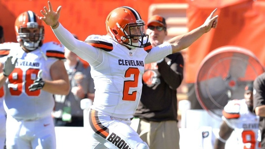 Cleveland Browns quarterback Johnny Manziel (2) celebrates after throwing a 50-yard touchdown pass to Travis Benjamin in the second half of an NFL football game against the Tennessee Titans, Sunday, Sept. 20, 2015, in Cleveland. (AP Photo/Ron Schwane)