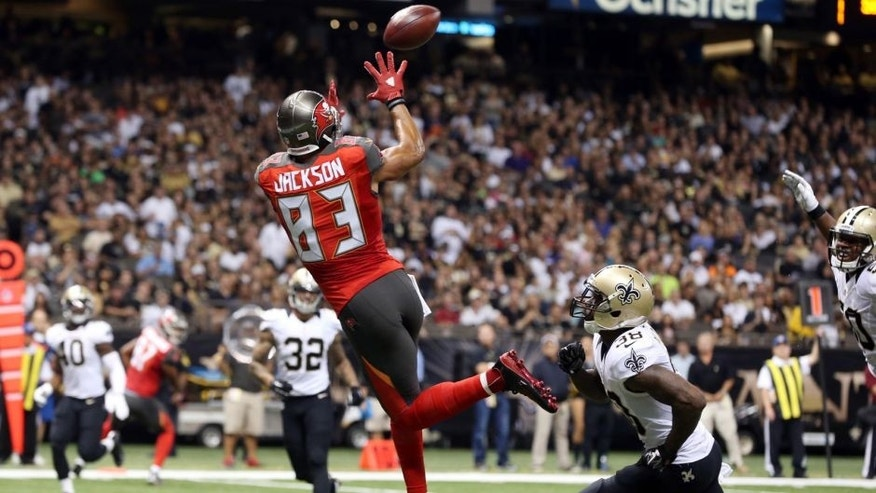 Sep 20, 2015; New Orleans, LA, USA; Tampa Bay Buccaneers wide receiver Vincent Jackson (83) catches the ball to score a touchdown in the second quarter against the New Orleans Saints at the Mercedes-Benz Superdome. Mandatory Credit: Chuck Cook-USA TODAY Sports