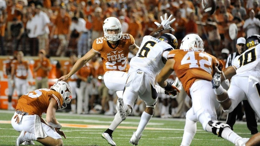 Sep 19, 2015; Austin, TX, USA; Texas Longhorns place kicker Nick Rose (23) attempts an extra point to tie the game against the California Golden Bears during the fourth quarter at Darrell K Royal-Texas Memorial Stadium. Cal beat Texas 45-44. Mandatory Credit: Brendan Maloney-USA TODAY Sports