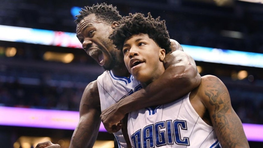 Orlando Magic forward Dewayne Dedmon, left, screams in celebration as he hugs guard Elfrid Payton, who scored during the fourth quarter of an NBA basketball game against the Sacramento Kings on Friday, March 6, 2015, in Orlando, Fla. The Magic won 119-114. (AP Photo/Orlando Sentinel, Stephen M. Dowell)