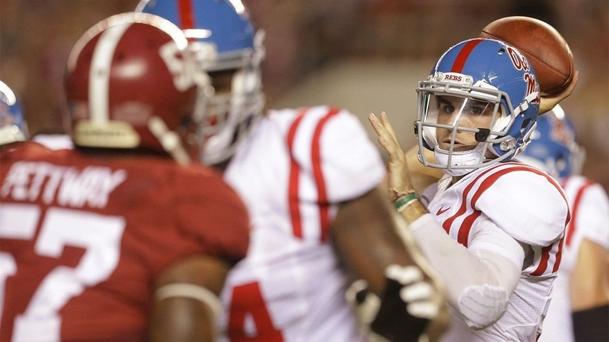 Mississippi quarterback Chad Kelly (10) passes the ball against Alabama during first half of an NCAA football game, Saturday, Sept. 19, 2015, in Tuscaloosa, Ala. (AP Photo/Butch Dill)