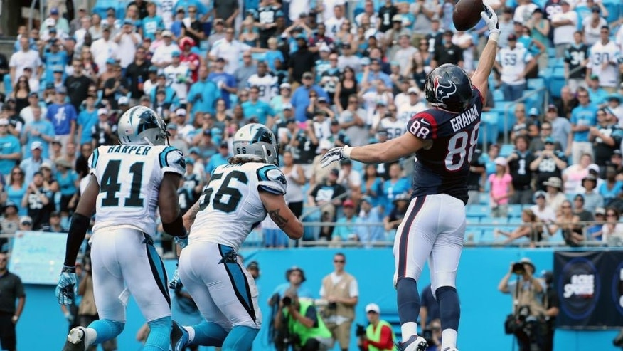 CHARLOTTE, NC - SEPTEMBER 20: Garrett Graham #88 of the Houston Texans makes a touchdown catch over Roman Harper #41 and A.J. Klein #56 of the Carolina Panthers in the third quarter during their game at Bank of America Stadium on September 20, 2015 in Charlotte, North Carolina. (Photo by Streeter Lecka/Getty Images)