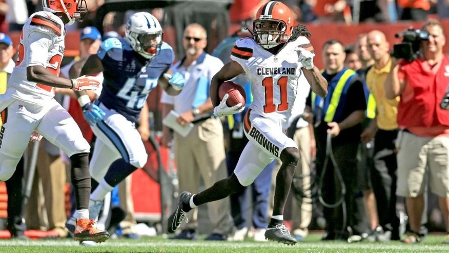 Sep 20, 2015; Cleveland, OH, USA; Cleveland Browns wide receiver Travis Benjamin (11) returns for a punt for a touchdown during the second quarter against the Tennessee Titans at FirstEnergy Stadium. Mandatory Credit: Andrew Weber-USA TODAY Sports