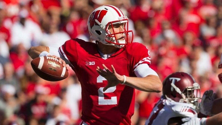 Wisconsin Badgers quarterback Joel Stave throws a pass against the Troy Trojans at Camp Randall Stadium in Madison, Wis., on Saturday, Sept. 19, 2015.