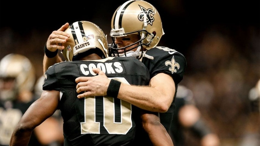 Oct 26, 2014; New Orleans, LA, USA; New Orleans Saints quarterback Drew Brees (9) celebrates with wide receiver Brandin Cooks (10) after a touchdown during the third quarter of a game against the Green Bay Packers at the Mercedes-Benz Superdome. Mandatory Credit: Derick E. Hingle-USA TODAY Sports