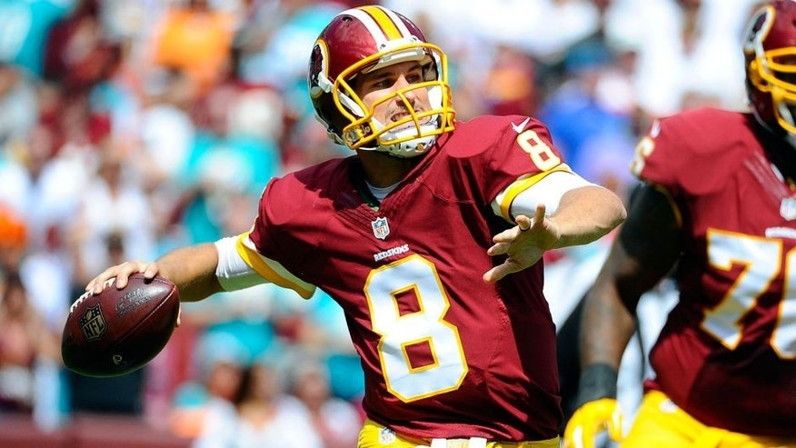 Sep 13, 2015; Landover, MD, USA; Washington Redskins quarterback Kirk Cousins (8) attempts a pass against the Miami Dolphins during the first half at FedEx Field. Mandatory Credit: Brad Mills-USA TODAY Sports