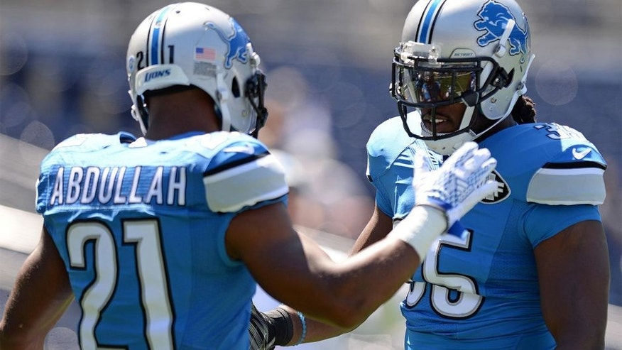 Sep 13, 2015; San Diego, CA, USA; Detroit Lions running back Joique Bell (35) and running back Ameer Abdullah (21) give each other five before the game against the San Diego Chargers at Qualcomm Stadium. Mandatory Credit: Jake Roth-USA TODAY Sports
