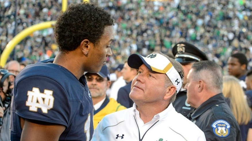 Sep 19, 2015; South Bend, IN, USA; Notre Dame Fighting Irish head coach Brian Kelly and quarterback DeShone Kizer (14) chat after Notre Dame defeated the Georgia Tech Yellow Jackets 30-22 at Notre Dame Stadium. Mandatory Credit: Matt Cashore-USA TODAY Sports