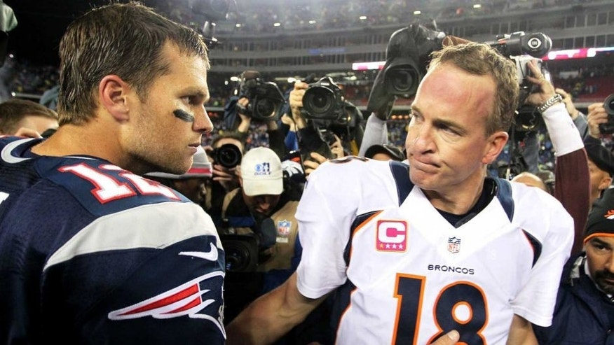 Oct 7, 2012; Foxborough, MA, USA; New England Patriots quarterback Tom Brady (12) shakes hands with Denver Broncos quarterback Peyton Manning (18) following the game at Gillette Stadium. The Patriots defeated the Broncos 31-21. Mandatory Credit: Stew Milne-USA TODAY Sports
