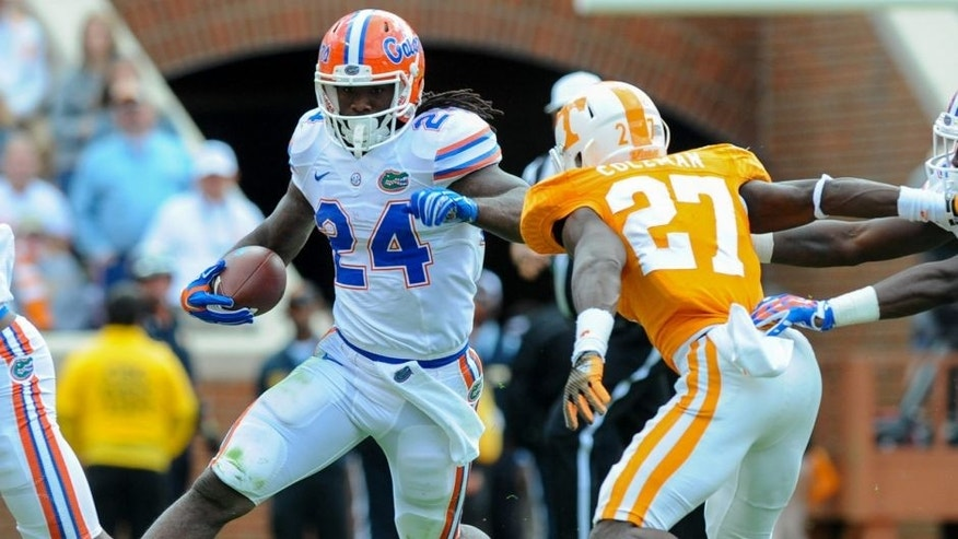 Oct 4, 2014; Knoxville, TN, USA; Florida Gators running back Matt Jones (24) runs the ball against Tennessee Volunteers defensive back Justin Coleman (27) during the second quarter at Neyland Stadium. Mandatory Credit: Randy Sartin-USA TODAY Sports