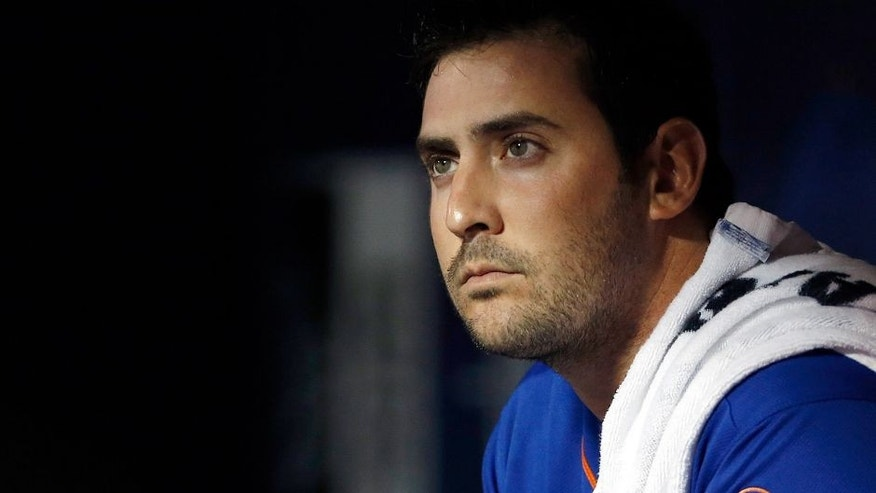 NEW YORK, NY - SEPTEMBER 20: Matt Harvey #33 of the New York Mets looks on from the dugout during the second inning against the New York Yankees at Citi Field on September 20, 2015 in the Queens borough of New York City. (Photo by Adam Hunger/Getty Images)