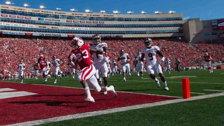 Saturday, Sept. 19: Wisconsin Badgers running back Dare Ogunbowale rushes for a touchdown during the first quarter against the Troy Trojans at Camp Randall Stadium in Madison, Wis.