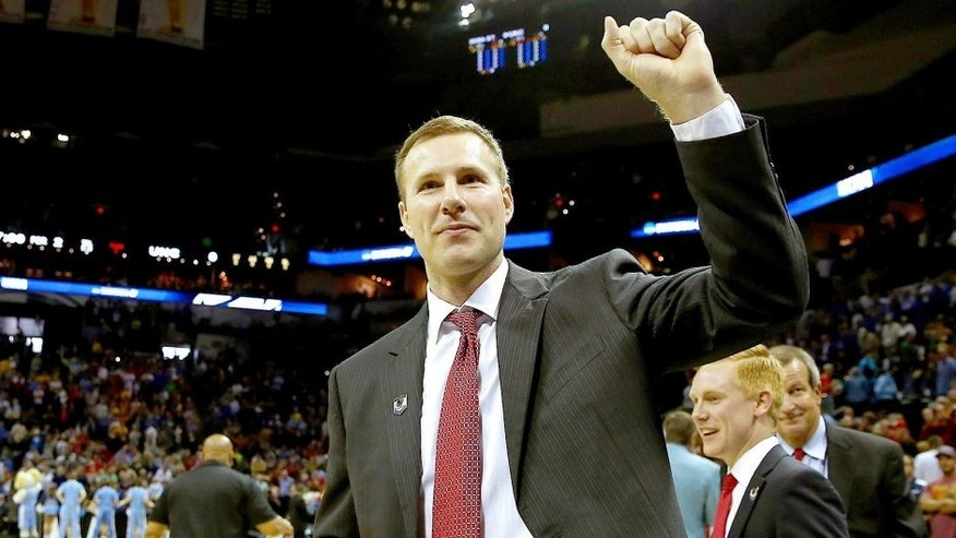 SAN ANTONIO, TX - MARCH 23: Head coach Fred Hoiberg of the Iowa State Cyclones reacts after defeating the North Carolina Tar Heels 85-83 in the third round of the 2014 NCAA Men's Basketball Tournament at the AT&T Center on March 23, 2014 in San Antonio, Texas. (Photo by Tom Pennington/Getty Images)