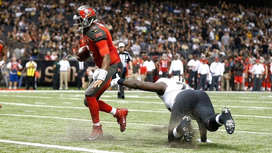 NEW ORLEANS, LA - SEPTEMBER 20: Jameis Winston #3 of the Tampa Bay Buccaneers avoids a tackle by Bobby Richardson #78 of the New Orleans Saints as he rushes for a touchdown during the third quarter of a game at the Mercedes-Benz Superdome on September 20, 2015 in New Orleans, Louisiana. (Photo by Wesley Hitt/Getty Images)