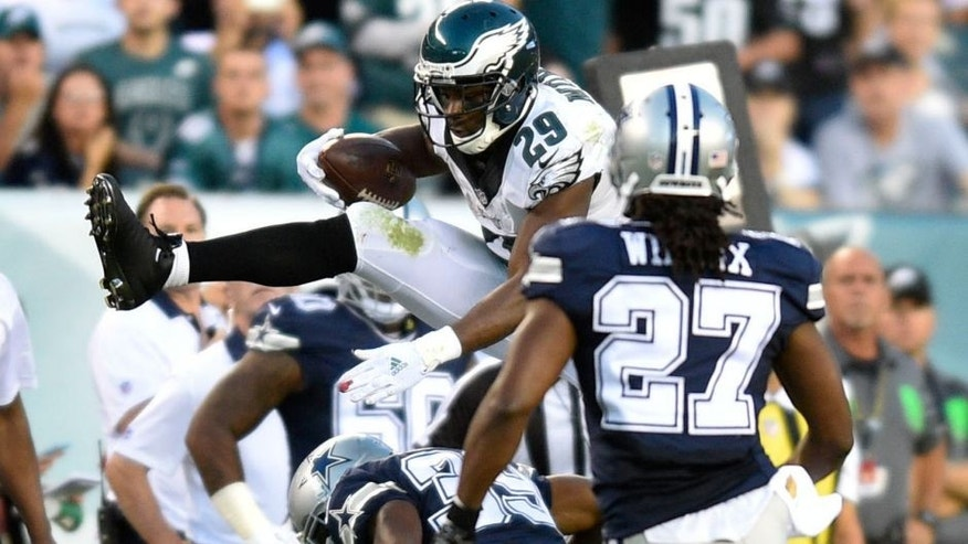 Sep 20, 2015; Philadelphia, PA, USA; Philadelphia Eagles running back DeMarco Murray (29) hurdles over Dallas Cowboys cornerback Brandon Carr (39) in the third quarter at Lincoln Financial Field. Dallas defeated Philadelphia 20-10. Mandatory Credit: James Lang-USA TODAY Sports