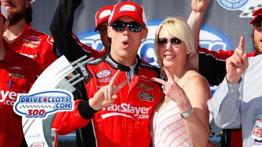 FONTANA, CA - MARCH 21: Kevin Harvick, driver of the #88 taxslayer.com Chevrolet, celebrates in Victory Lane with his wife DeLana after winning the NASCAR XFINITY Series Drive4Clots.com 300 at Auto Club Speedway on March 21, 2015 in Fontana, California. (Photo by Matt Sullivan/NASCAR via Getty Images)