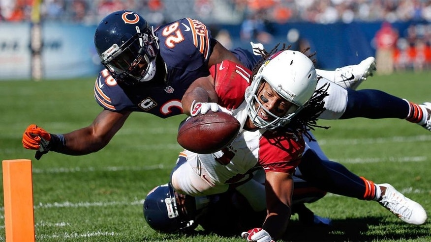 Sep 20, 2015; Chicago, IL, USA; Arizona Cardinals wide receiver Larry Fitzgerald (11) scores a touchdown against Chicago Bears cornerback Terrance Mitchell (20) and strong safety Antrel Rolle (26) during the second half of the NFL game at Soldier Field. Cardinals won 48-23. Mandatory Credit: Kamil Krzaczynski-USA TODAY Sports