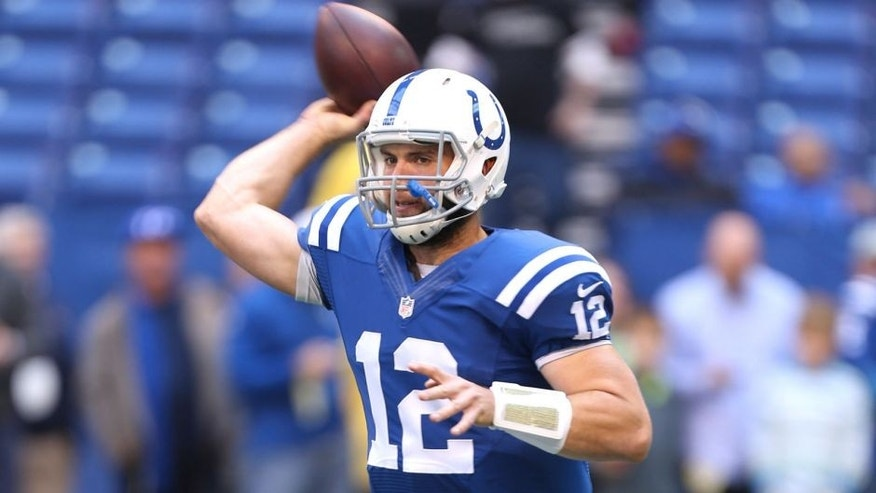 Oct 19, 2014; Indianapolis, IN, USA; Indianapolis Colts quarterback Andrew Luck (12) throws a pass before the game against the Cincinnati Bengals at Lucas Oil Stadium. Mandatory Credit: Brian Spurlock-USA TODAY Sports