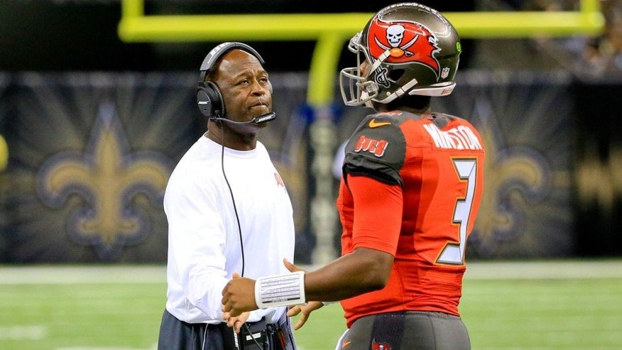Sep 20, 2015; New Orleans, LA, USA; Tampa Bay Buccaneers head coach Lovie Smith (L) talks to quarterback Jameis Winston (3) during the second half against the New Orleans Saints at the Mercedes-Benz Superdome. The Buccaneers won 26-19. Mandatory Credit: Derick E. Hingle-USA TODAY Sports