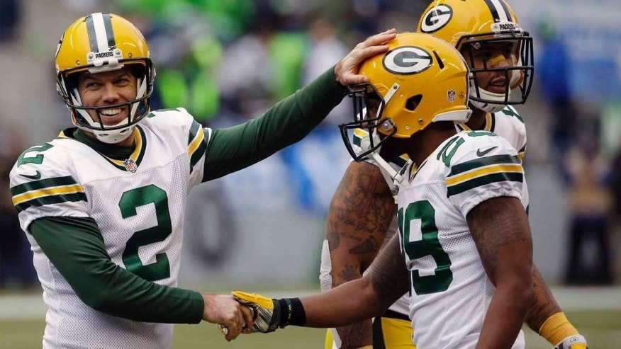 The Green Bay Packers' Mason Crosby (left) is congratulated after making a field goal during the second half of the NFC championship game in Seattle.