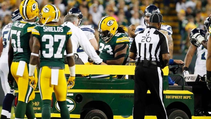 The Green Bay Packers' Josh Boyd leaves the game on a cart during the first half of an NFL football game against the Seattle Seahawks on Sunday, Sept. 20, 2015, in Green Bay, Wis.