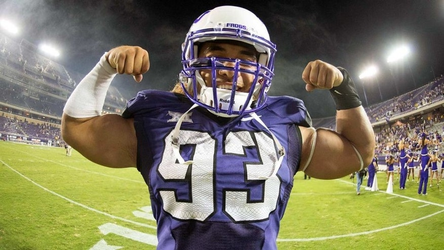 Aug 30, 2014; Fort Worth, TX, USA; TCU Horned Frogs defensive end Mike Tuaua (93) poses for a photo after the game against the Samford Bulldogs at Amon G. Carter Stadium. Tuaua has two sacks and forces two fumbles. The Horned Frogs defeated the Bulldogs 48-14. Mandatory Credit: Jerome Miron-USA TODAY Sports