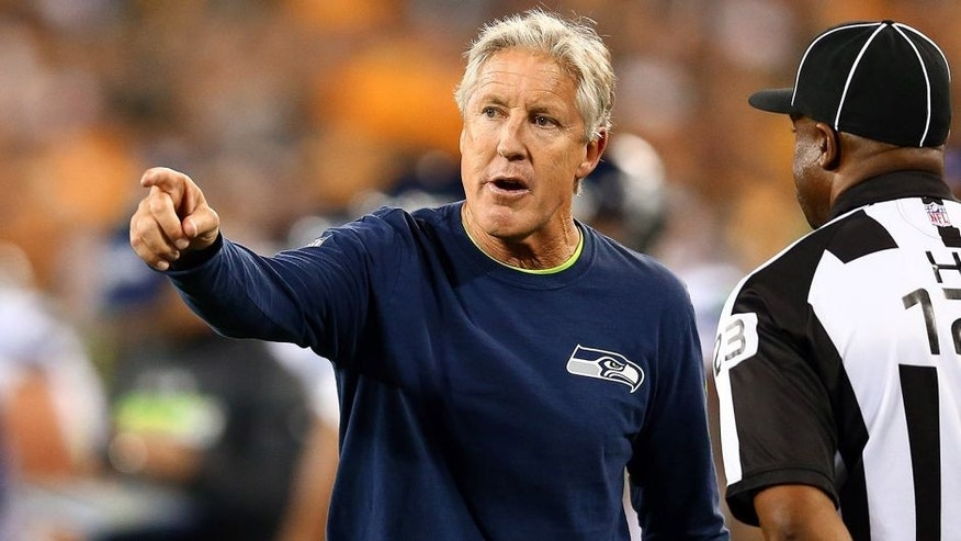 GREEN BAY, WI - SEPTEMBER 20: Head coach Pete Carroll of the Seattle Seahawks reacts to line judge Ed Walker #123 during their game against the Green Bay Packers at Lambeau Field on September 20, 2015 in Green Bay, Wisconsin. (Photo by Maddie Meyer/Getty Images)