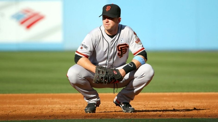 LOS ANGELES, CA - JUNE 21: Buster Posey #28 of the San Francisco Giants looks on from first base in between pitches during the MLB game against the Los Angeles Dodgers at Dodger Stadium on June 21, 2015 in Los Angeles, California. The Dodgers defeated the Giants 10-2. (Photo by Victor Decolongon/Getty Images)