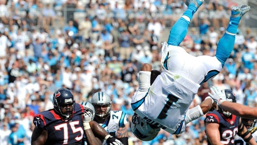Sep 20, 2015; Charlotte, NC, USA; Carolina Panthers quarterback Cam Newton (1) leaps over the line of scrimmage for a touchdown during the second half of the game against the Houston Texans at Bank of America Stadium. Mandatory Credit: Sam Sharpe-USA TODAY Sports